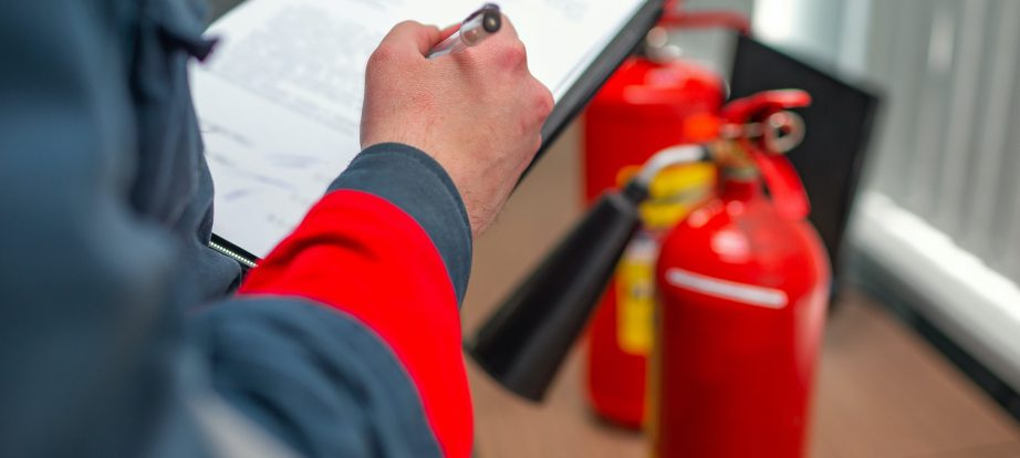 Engineer Professional are Checking A Fire Extinguisher Using Clipboard or checking Industrial fire control system,Fire Alarm controller, Fire notifier, Anti fire.System ready In the event of a fire.